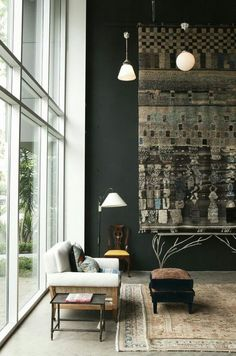 I uploaded this Pin and I love how the dark wall is against the all-window wall. The rug hanging emphasizes the ceiling structure.
