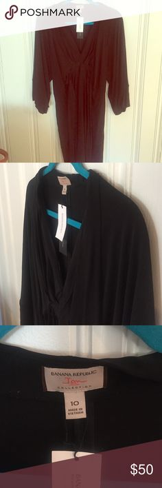 Banana Republic, size 10, black dress, EUC From their collaboration with Issa London, this kimono style black wrap dress is beautiful. Never worn and still has tags but am listing as EUC since it's been in storage. Banana Republic Dresses Mini