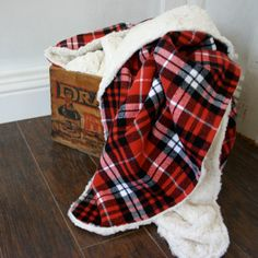 Soft, thick red plaid flannel fabric, backed with a cozy off-white minky fabric. This blanket is just waiting to be snuggled with by your little, or you! So COZY! The deluxe minky is soft and warm. The plaid flannel fits into any rustic, woodland, or cozy room decor. More geared to