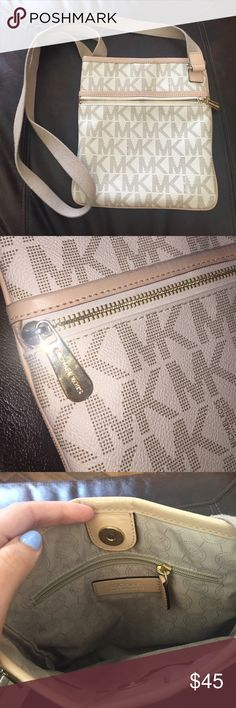 Michael Kors cross body bag Cream colored MK cross body bag. Good condition. Slightly used -black mark on one seam. No other marks or scratches. Michael Kors Bags Crossbody Bags