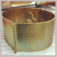 Medieval textured brass cuff with smashed copper rivets. By Pamela DeSantis Tachibana