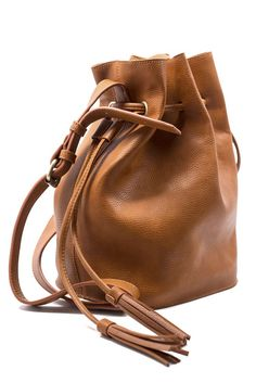 Bring all your treasures along in this beautiful bucket bag. | @andwhatelse