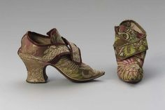 Pair of women's shoes with matching clogs        Possibly English, early 1730s         England (possibly)  Dimensions      14.5 x 9 x 22.5 cm (5 11/16 x 3 9/16 x 8 7/8 in.)  Medium or Technique      Silk lampas, silk plian weave trim, linen, silk satin and leather lining, and leather sole