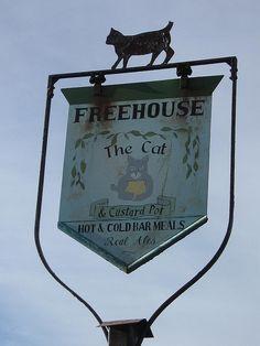 Sign outside The Cat & Custard Pot pub, Paddlesworth