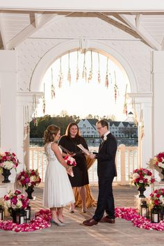 Red, white and pink rose aisle decor, petal swirls and hanging flowers at Disney's Sea Breeze Point for a vow renewal.