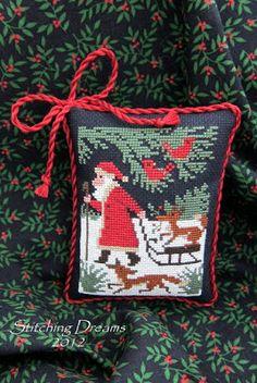 "Designer :Prairie Schooler's Book No.110 ""Santa & Friends:   Fabric:  18 ct. black Aida Threads:  DMC Stitched by  Carol I."