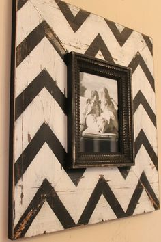 Picture frame over a painted board.....great idea for my goodwill frames Family space