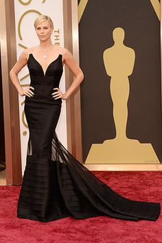 Charlize Theron, in Dior Haute Couture, with Harry Winston jewels.