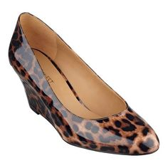 A wrapped wedge elevates the classic pump with a sleek, contemporary profile. Padded footbed for all-day comfort. Various uppers - simply place your mouse over the color or print in which you're interested to determine upper. Man-made lining and sole. Imported. 3 inch mid-heels. Women's shoes. Mid-heel pumps.