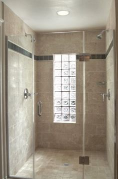 Glass block, two shower heads and room for two! Love it!