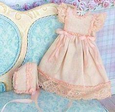 miniature child's dress and bonnet