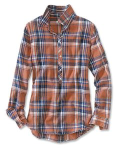 One to wear layered with slim jeans and leggings, chunky sweaters, and cute boots, this soft, yarn-dyed orange plaid popover shirt adds a welcome burst of color to your fall neutrals. A soft indigo wash over our original orange-drenched plaid lends to the gently weathered look and makes each shirt unique.