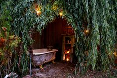 The weeping willow tree in the corner of the yard became the ideal spot for an outdoor bathing area. A friend found an old claw-foot tub for...