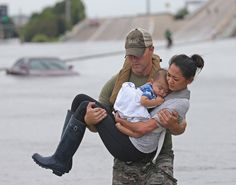 Houston police officer Daryl Hudeck carries Catherine Pham & her 13-month-old son, Aidan, after rescuing them from floodwaters on Sunday, 27 August 2017. photo: Louis DeLuca/Dallas Morning News    story behind the photo: https://www.dallasnews.com/news/weather/2017/08/28/felt-relief-story-behind-touching-photo-baby-asleep-harvey-rescue    full sized original: http://globalfinance.zenfs.com/images/US_AHTTP_AP_NEWSBRIEFS/dd6c7a3cf6b84dd7b6e5cc76ab730f76_original.jpg