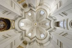 """ITALIAN BAROQUE ARCHITECTURE, Borromini; Interior of the dome of Sant'ivo alla Sapienza, 1642-60, Rome, by Borromini. """"Vertical support piers are placed at the inner angles of the star to form a circle. The dome has a faceted surface without precedent in Renaissance building, but, as Borromnini well knew, present in late antique buildings such as the serapaeum and the pavilion of the Piazza d'Oro at Hadrian's villa at Tivoli."""""""
