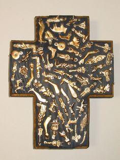 cross decoarted with milagros/ex votos