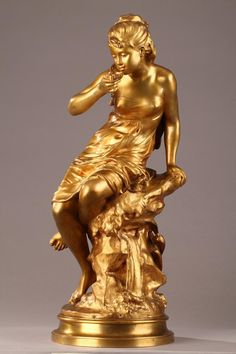 """Gilt bronze sculpture titled """"La Source"""" (The Spring), portraying a young woman drinking water from a spring using a shell as her cup. The sculpture is set on a terraced, circular base. The sculpture can turn on its base. Art Sculpture, Abstract Sculpture, Bronze Sculpture, Metal Sculptures, New Background Images, Gold Aesthetic, Classical Art, Gold Art, Oeuvre D'art"""