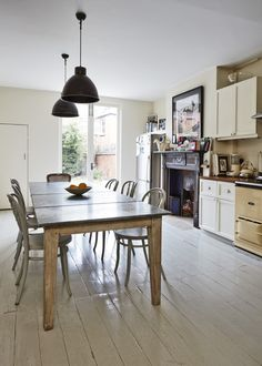 Chloe Lonsdale of MiH Jeans' cool Notting Hill kitchen. Love the off-white floorboards.