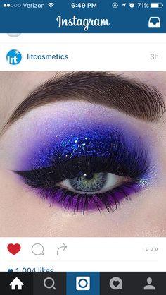 Dramatic cobalt glitter eye with a purple lash line