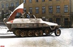 """Gray Wolf"" with Polish national flag - German armored fighting vehicle SdKfz 251 captured by the Warsaw insurgents- ""Krybar"" Regiment, on August 1944 from SS Panzer Division Wiking. Warsaw Ghetto, Warsaw Poland, Poland Ww2, Warsaw Uprising, Ww2 Photos, History Online, Army Vehicles, Armored Vehicles, Armored Fighting Vehicle"