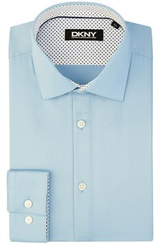 This DKNY slim fit skt blue single cuff shirt is inspired from the energy and spirit of the streets of New York.It is stylish and slim fitted shirt and is cotton rich with a sateen finish. This shirt looks great worn formally to work with a slim DKNY tie or wear open necked for an evening out.