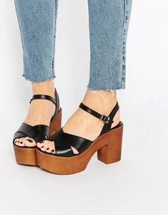 Black wood heels sandals. Totally in love.