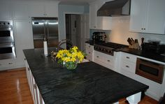 Beautiful Hudson Ash counters in the kitchen by Saratoga Soapstone. #countertops #stone