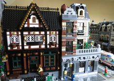 "This is a Pub : a mix of different inspiration.  You can see on the right in the angle a ""copy"" of this www.flickr.com/photos/25309284@N02/7660809536/  This Moc wins the modular madness"