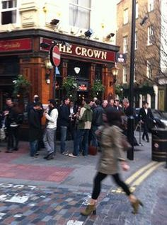 At any time, London is a vibrant destination, famed for its pub life. At happy hour, patrons spill out into the streets enjoying a pint. This is The Crown in Seven Dials near SoHo.
