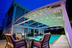 Swimming pool covering roof # luxury #led lights # www.creativedesignind.con