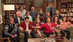 """Penny says, """"Aunt Voula (Andrea Martin) holds court in flaming red. Paris is behind her trading back with gray for gray with black. Her non-Greek grandparents--Rodney Miller (Bruce Gray) and Harriet Miler (Fiona Reid)--are on the left edge of row two. Otherwise everyone else is Greek, Greek, Greek. Otherwise, why would their weddings be so big."""""""