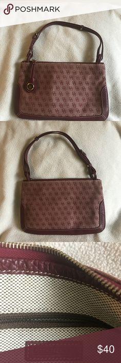 d252e22fa332 Dooney & Bourke signature slim zip top purse An authentic Dooney & Bourke  burgundy color signature