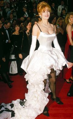 Excessive ruffles gave the leggy lady's 1992 Oscar Ruth Meyers and Bill Hargate look a costume-like quality. Oscar Fashion, Fashion Fail, Jodie Foster, Mullet Dress, Geena Davis, Spring, Wise Women, Gwyneth Paltrow, Celebs