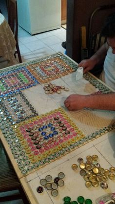 Bottlecap table putting on one by one