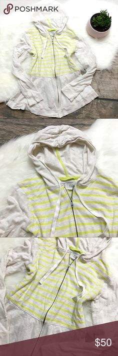 ANTHROPOLOGIE Neon Striped Peplum Hoodie ANTHROPOLOGIE Neon Striped Peplum Hoodie by Saturday/Sunday. Oatmeal Heather with yellow neon stripes and a girly Peplum flare makes this cozy hoodie a must have. Gently worn and lightly pilled. Overall good condition. Size medium. Anthropologie Tops Sweatshirts & Hoodies