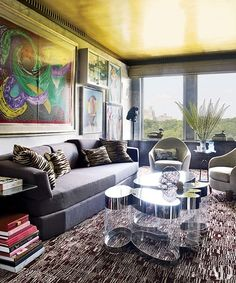 Works by David Hockney, George Condo, Damien Hirst, and Fernando Botero are grouped in the library; the Salomé de Fontainieu sofa is from Galerie Diane de Polignac, the Guy de Rougemont cocktail table is from Galerie du Passage, and the carpet is by Stark.