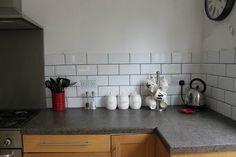 Progress Report:  White Brick Tiles and Shiny Cooker Hoods