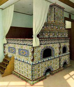 An out-of-medieval-period Russian stove, with stairs leading to a sleeping platform. Can you say roasty-toasty on a frigid winter's night?