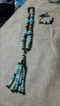 42 inch Amonozite and Hematite Toggle Clasp Necklace. Tassle is removable.  You can wear it 3 different ways. $75.00