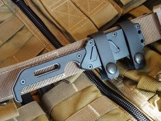 """Outland's Kryptos knife was developed in cooperation with America's Special Operations Forces for optimum concealed carry, swift and natural draw, and reliable retention. The handle shape, sheath profile and strap system have been designed for discreet horizontal carry on 1.5"""" tactical belts. The sheath is ambidextrous for right or left-handed draw and can"""