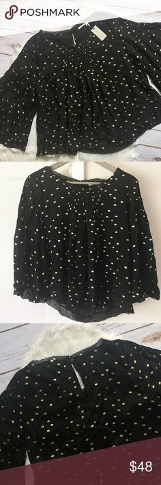 """NWT Anthro Dotted Top Floreat label from Anthropologie. NWT. Black top with gold spots. Loose fit. Wide, bell half sleeves. Round neck. Pleat detail center front at top. Keyhole and button closure at top back. Spare button on care tag. Body lined, sleeves unlined. Shell 100% Viscose. Lining 100% Polyester. Measurements on one side when laid flat: Length about 21.5"""" long from top of shoulder to hem. Underarm to underarm about 18.5"""". Hem flares out to about 27.5"""". Anthropologie Tops Blouses"""