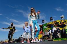 Danica Patrick is escorted by her niece, Miss Reese Selman, during Driver Intros for the Teenage Mutant Ninja Turtles 400 at Chicagoland Speedway, 9/18/16. #WarriorMini <3
