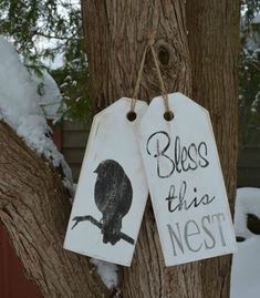 """Welcome sign """"Bless this nest"""".  Black and white large tags for front door.  Rustic, distressed, antiqued wood."""