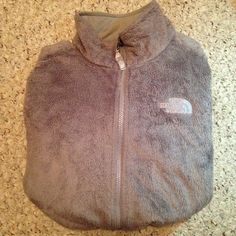 Grey osito northface Fuzzy grey northface is great condition. Only has one flaw which is a hole on the inside pocket and you can't even see it! North Face Jackets & Coats