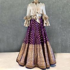 Banarasi lehenga - Jayanti Reddy signature brocade lehenga paired with a ruffled button down tieup shirt Beautiful purple color brocade lehenga with ivory ruffled button shirt Contact on or email on ja Indian Fashion Dresses, Indian Gowns Dresses, Dress Indian Style, Indian Designer Outfits, Indian Outfits, Indian Skirt And Top, Brocade Lehenga, Banarasi Lehenga, Anarkali