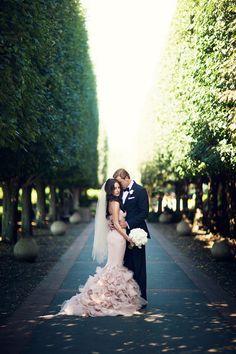 Romantic  blush gown in botanical garden.