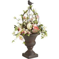 Spring makes a grand entrance this year with faux florals gathered into a topiary and topped with a bunny. Place it in your entryway, on a console table in your living room or atop a buffet in your dining room for elegant Easter entertaining.