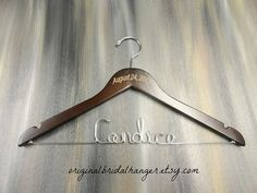 Engraved Wire Name Hanger Custom Name by OriginalBridalHanger Your #WeddingDressHanger can be created to fit your needs.  I offer a variety of choices from plain to #Engraved. I also offer #PaintedHangers, #PersonalizedWireHangers, and #NoWireHangers. #BrideHangers, $30