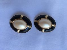 See new listings daily - follow us for updates.  Vintage Signed #Carolee Black Enamel and Gold Tone Earrings - Clip On Earrings - Oval #Pearlescent #Cabochon Black Enamel & Gold Tone Earrings - Offered by MimisJewelryBoutiqu... #vintage #jewelry #teamlove #etsyretwt #bestofetsy #carolee #cabochon #mimisjewelryboutique #pearlescent ➡️ http://jto.li/eFmpF