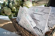 DIY wedding programs made in to fans for outdoor wedding.